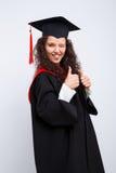 Estudiante en vestido de la graduación Imagen de archivo