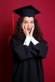 Estudiante en vestido de la graduación Imágenes de archivo libres de regalías