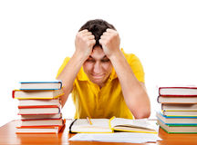 Estudiante enfadado con los libros Imagenes de archivo