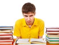 Estudiante enfadado con los libros Foto de archivo