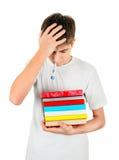 Estudiante enfermo con los libros Imagenes de archivo