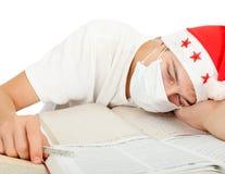 Estudiante enfermo en el sombrero de santa Foto de archivo