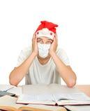 Estudiante enfermo en el sombrero de Santas Fotos de archivo libres de regalías