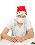 Estudiante enfermo en Santa Hat Fotos de archivo libres de regalías