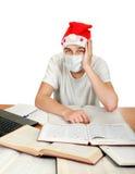 Estudiante enfermo en Santa Hat Imágenes de archivo libres de regalías