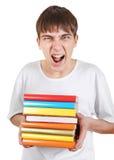 Estudiante enojado con libros Fotografía de archivo