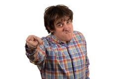 Estudiante enojado joven que señala en usted foto de archivo libre de regalías