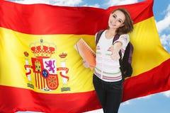 Estudiante español Gesturing Thumb Up Imágenes de archivo libres de regalías