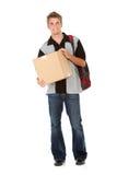 Estudiante: Estudiante adolescente Carrying Cardboard Box Imagen de archivo libre de regalías
