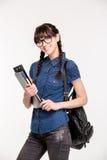 Estudiante feliz con la mochila y las carpetas Imagen de archivo libre de regalías