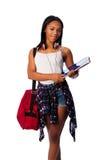 Estudiante feliz con las carpetas y el bolso Fotos de archivo