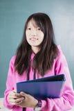 Estudiante feliz con los apoyos Imagen de archivo