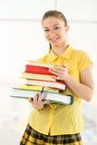 Estudiante feliz con los libros Imágenes de archivo libres de regalías