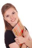 Estudiante feliz con un cuaderno Imágenes de archivo libres de regalías