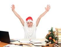Estudiante feliz en el sombrero de santa Imagen de archivo