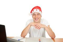 Estudiante feliz en el sombrero de santa Fotografía de archivo libre de regalías