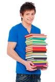 Estudiante feliz joven con los libros. Imagen de archivo