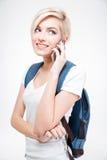 Estudiante feliz que habla en el teléfono Foto de archivo libre de regalías