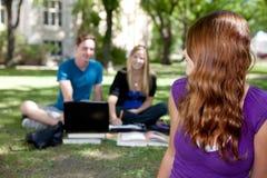 Estudiante feliz que mira detrás Foto de archivo