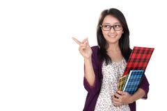 Estudiante feliz que señala en el copyspace Imagen de archivo libre de regalías