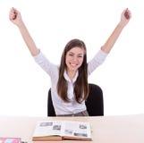Estudiante feliz que se sienta fotografía de archivo