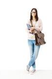 Estudiante feliz que sostiene el bolso del libro y de escuela.  Fotos de archivo libres de regalías