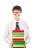 Estudiante feliz que sostiene la pila de los libros Imagenes de archivo