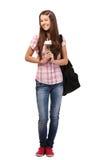 Estudiante feliz que sostiene una flor, aislada en blanco Fotografía de archivo libre de regalías