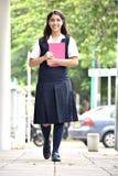 Estudiante feliz Walking To School imagen de archivo libre de regalías