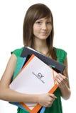 Estudiante femenino con CV de la cartera, curriculum vitae Foto de archivo libre de regalías