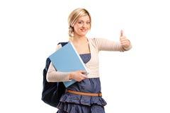 Estudiante femenino con el pulgar para arriba Imagenes de archivo