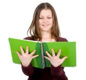 Estudiante femenino con los cuadernos Fotografía de archivo libre de regalías