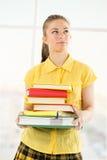 Estudiante femenino con los libros Fotografía de archivo libre de regalías