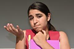 Estudiante femenino confuso Imágenes de archivo libres de regalías
