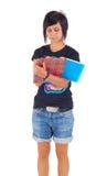 Estudiante femenino, escribiendo en el copybook, aislado Imágenes de archivo libres de regalías