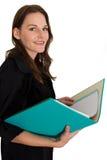 Estudiante femenino joven con una carpeta/una carpeta Fotos de archivo