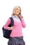 Estudiante femenino que habla en un teléfono Imagen de archivo