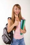 Estudiante femenino sonriente con los libros en manos Foto de archivo