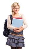 Estudiante femenino sonriente con un bolso de escuela Foto de archivo libre de regalías