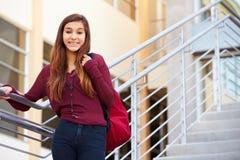 Estudiante femenino Standing Outside Building de la High School secundaria Imagen de archivo libre de regalías
