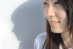 Estudiante femenino y su sombra Imágenes de archivo libres de regalías