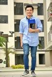 Estudiante filipino Smiling Walking del muchacho fotografía de archivo libre de regalías