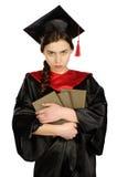 Estudiante graduada hermosa en capa Fotos de archivo libres de regalías