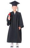 Estudiante graduado del muchacho en capa Fotografía de archivo libre de regalías