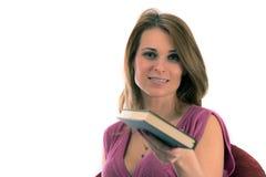 Estudiante hermoso con los libros en el backgr blanco Foto de archivo