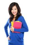 Estudiante hermoso que sostiene los cuadernos Fotografía de archivo libre de regalías