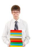 Estudiante Holding Pile de los libros Imagenes de archivo
