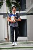 Estudiante impasible Walking On Campus del muchacho fotos de archivo libres de regalías