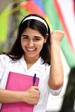 Estudiante internacional adolescente femenino emocionado Foto de archivo
