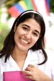 Estudiante internacional adolescente femenino sonriente Imagen de archivo libre de regalías